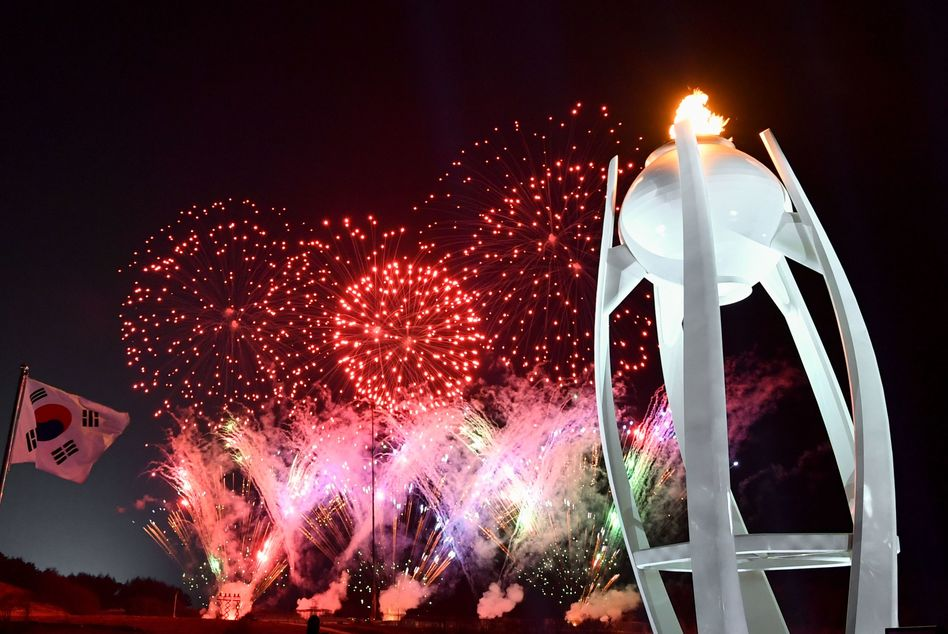 The torch and fireworks during the Closing Ceremony. The South Korean flag to the left.