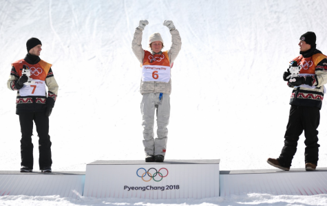 Red Gerard posing on the Gold Medal podium.  (Photo: Clive Rose/Getty Images)