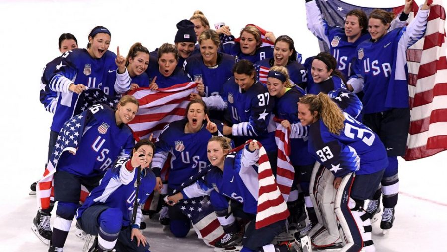 USA Women's Ice Hockey Team celebrating their gold medal win. (Photo: Harry How/Getty Images)