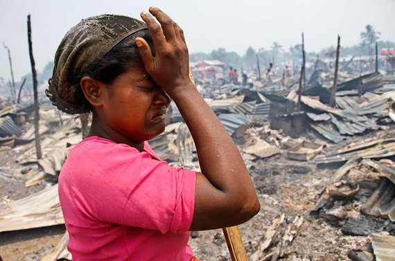 Rohyinga Muslim girl looking over destroyed village.