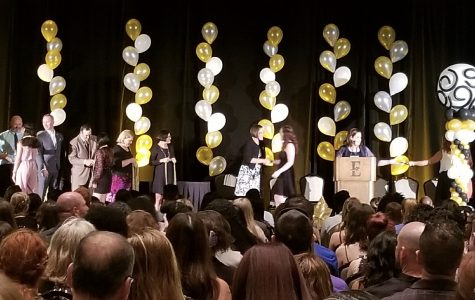 OCSA seniors being awarded their cords on stage.