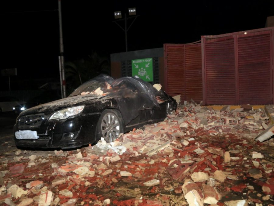 A car totaled by fallen debris from the earthquake.