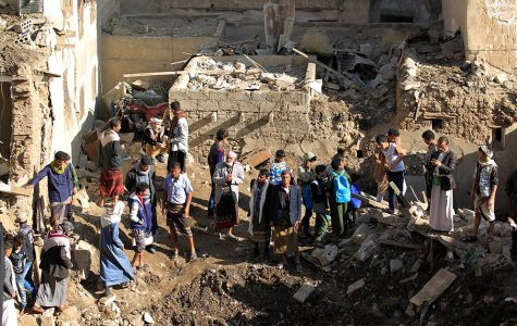 People examining damage done by an airstrike in the Yemeni capital.