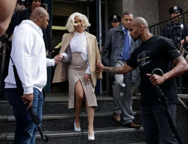 Cardi B leaves a New York police precinct, Oct. 1, 2018, in Queens after she was arrested and charged with endangerment and assault