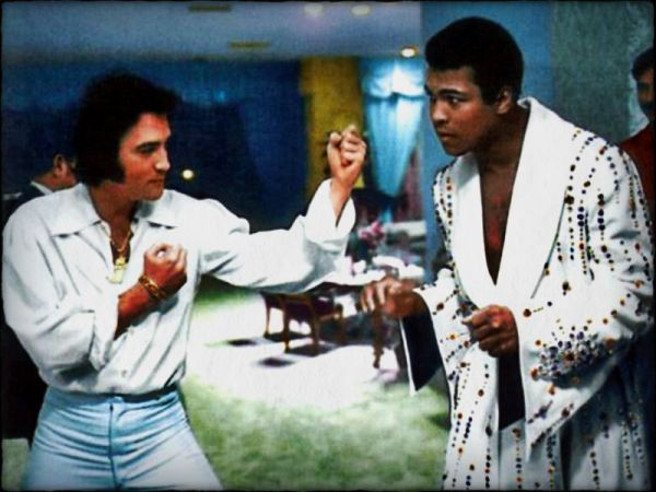 Elvis Presley and Muhammed Ali, both recipients of The Presidential Medal of Freedom, pose in a legendary photo shoot in 1974.