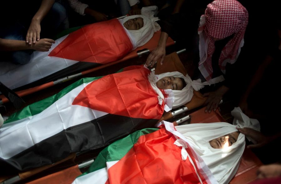 The three teens were wrapped in Palestinian flags.
