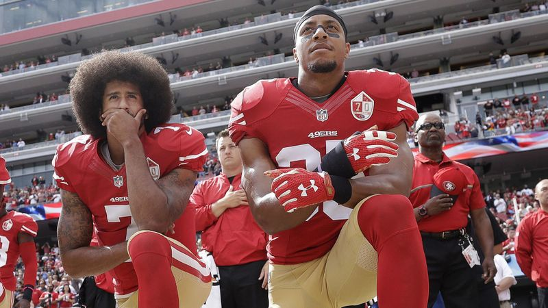 San Francisco 49ers quarterback Colin Kaepernick, left, and safety Eric Reid kneel during the national anthem before a game against the Dallas Cowboys on Oct. 2, 2016