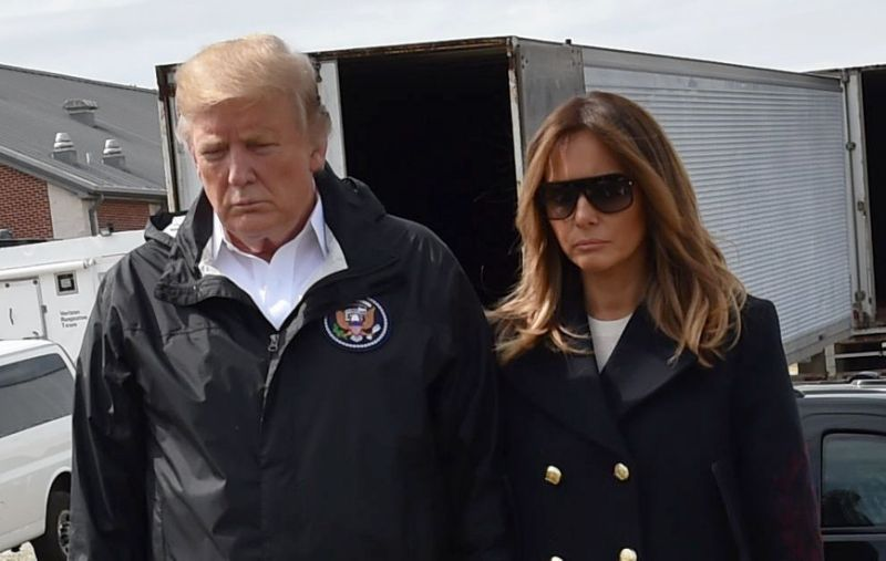 President Trump and first lady Melania Trump stand outside Providence Baptist Church in Opelika, Ala., during a tour of tornado-damaged areas on March 8