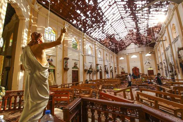 Officials+investigate+the+damage+in+St.+Sebastian%27s+Church+caused+by+one+of+six+suicide+bombings+in+Sri+Lanka+on+Easter.