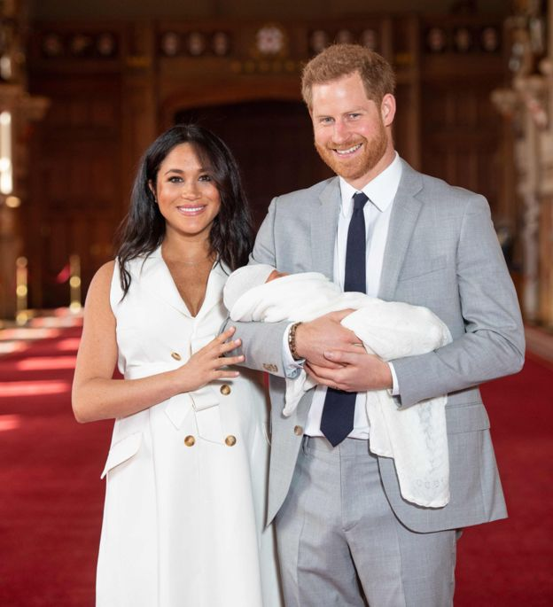 Prince Harry and Meghan, the Duke and Duchess of Sussex, posing with their newborn son.