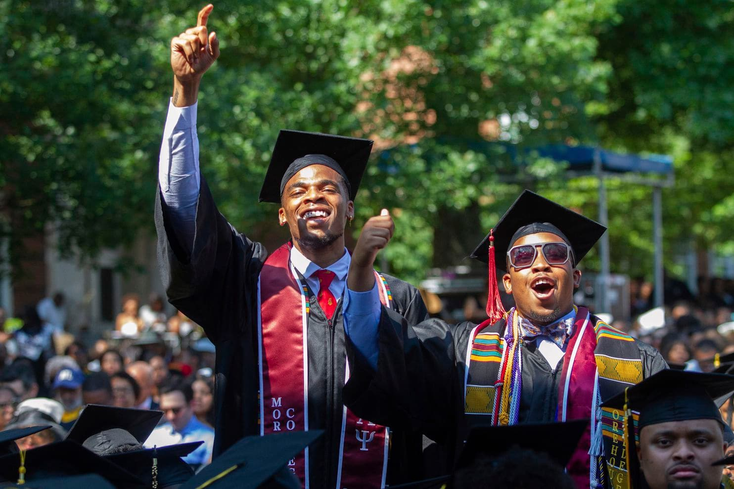 The Morehouse College graduates after hearing billionaire and philanthropist Robert F. Smith say that he would pay student loan debts.