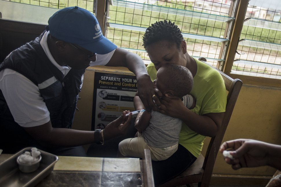 A doctor with the World Health Organization administers a vaccine to a child at Ewin Polyclinic in Cape Coast, Ghana, on April 30, 2019. In the coming weeks the vaccine will be administered throughout the rest of the country and in Kenya.