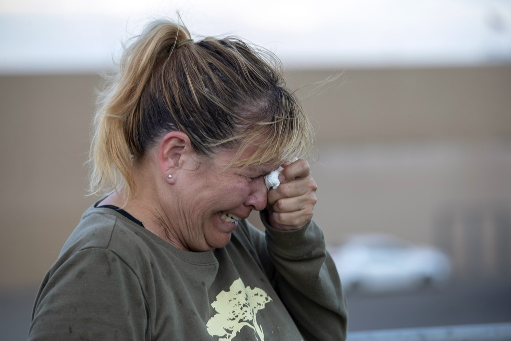 Edie Hallberg searches for her mother after a mass shooting at a Walmart in El Paso, Texas.