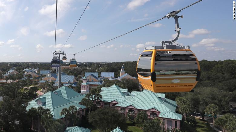 Gondolas move to various locations at Walt Disney World on the Disney Skyliner aerial tram, Friday, Sept. 27, 2019, in Lake Buena Vista, Fla. (AP Photo/John Raoux)