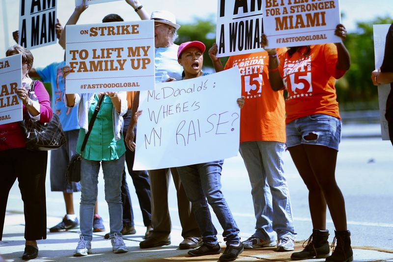 McDonald's employees standing outside a McDonald's restaurant in Miramar demanding a pay increase to $15 an hour.