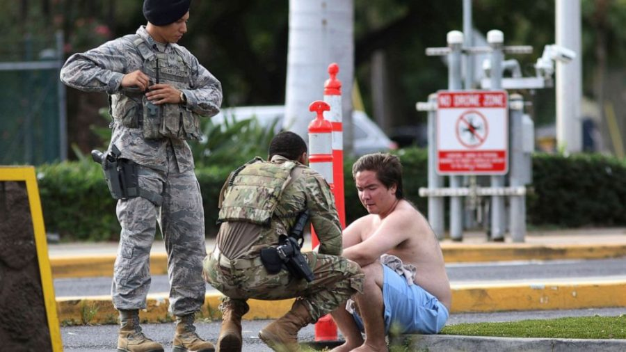Security+forces+attend+to+an+unidentified+male+outside+the+the+main+gate+at+Joint+Base+Pearl+Harbor-Hickam%2C+Wednesday%2C+Dec.+4%2C+2019%2C+in+Hawaii%2C+following+a+shooting.