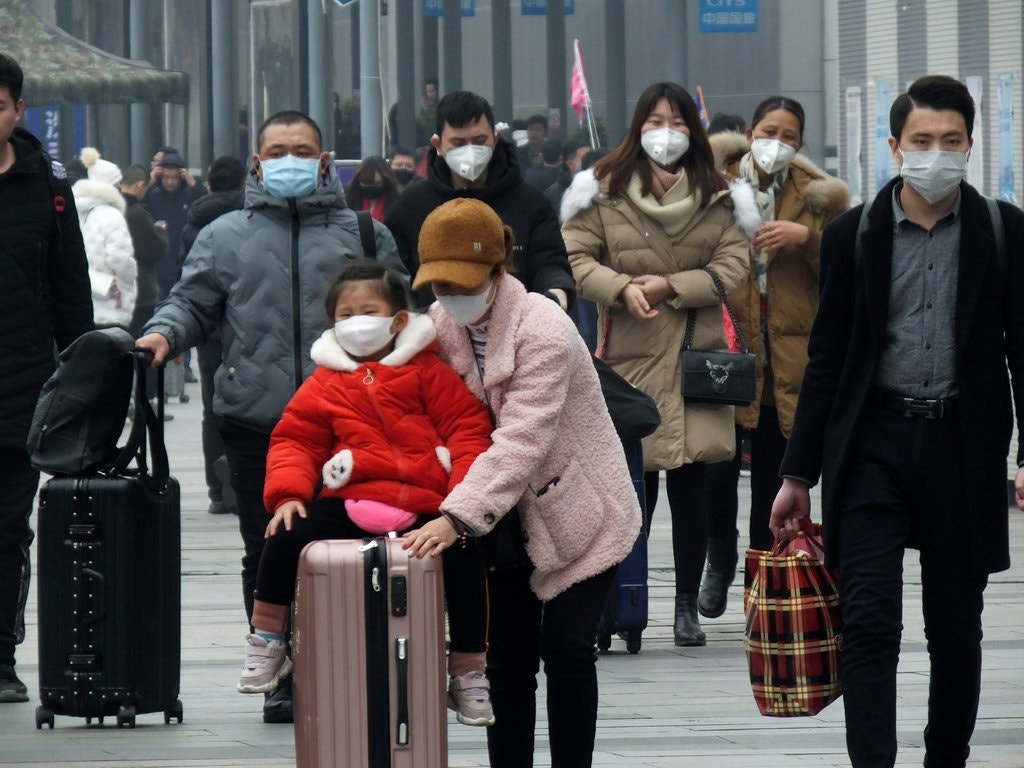 Travelers at a train station in Yichang, China, about 200 miles from Wuhan. The Lunar New Year, which begins on Saturday, marks the region's busiest travel season.
