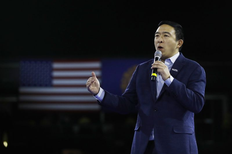 Democratic presidential candidate businessman Andrew Yang speaks at the McIntyre-Shaheen 100 Club Dinner, Saturday, Feb. 8, 2020, in Manchester, N.H.