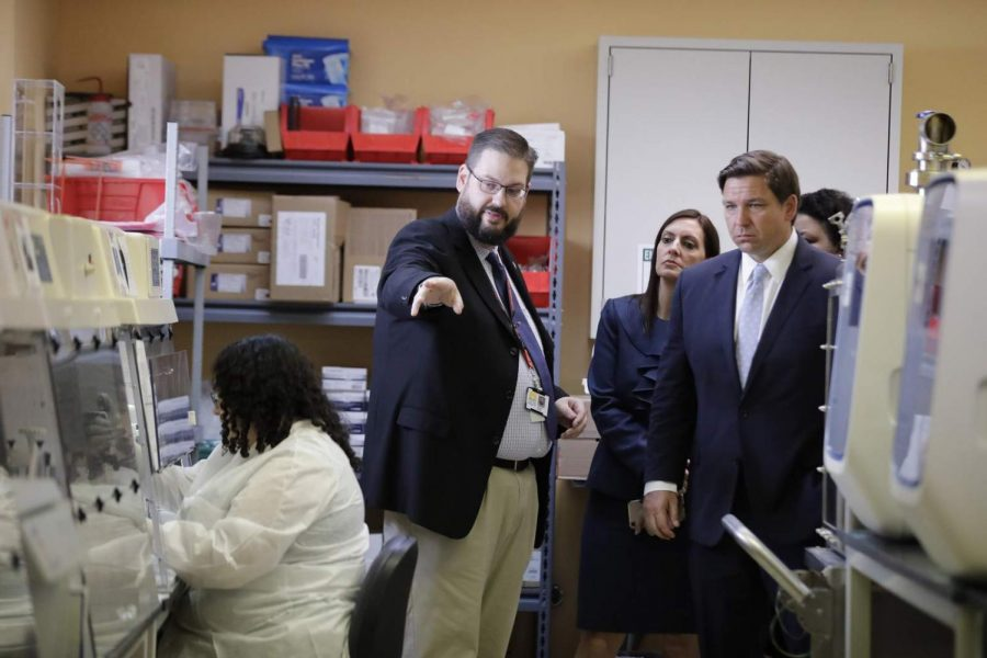 Director Stephen White, giving Ron DeSantis a tour of the Florida's Bureau of Public Health Laboratories on March 2nd.