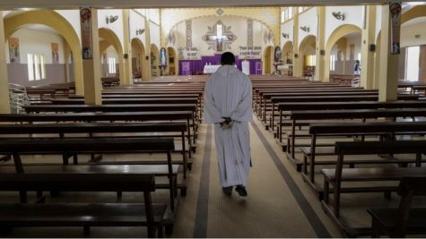 A priest at Saint Joseph Church walks along the empty nave during Sunday mass after prayers were suspended over concerns about the spread of coronavirus in Dakar, Senegal [Sylvain Cherkaoui/ReutersM