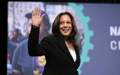 Senator Kamala Harris waving at the audience of the 2019 National Forum on Wages and Working People in Las Vegas, Nevada.