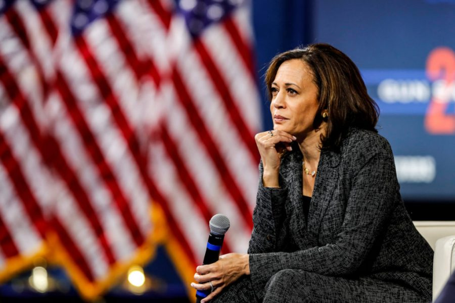 Kamala Harris with a microphone in hand.