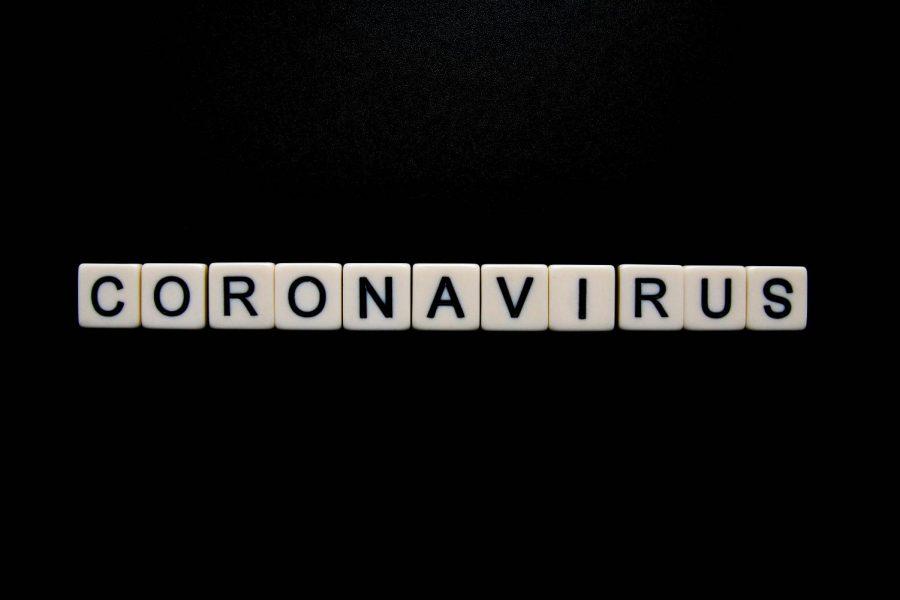 Coronavirus spelled out in white dice