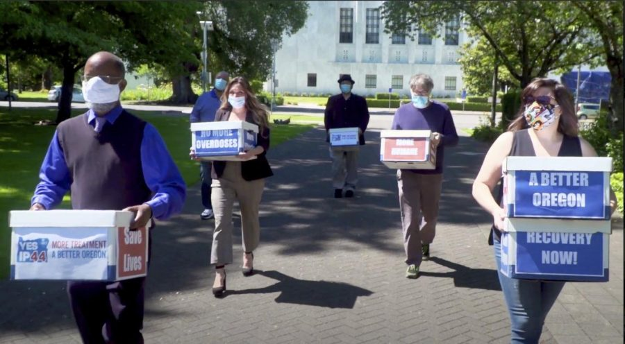 Campaign volunteers delivering boxes containing singed petitions to the Oregon Secretary of State's office in Salem, Wisconsin.