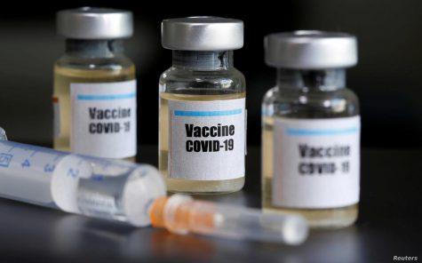 Moderna COVID-19 vaccine and needle.