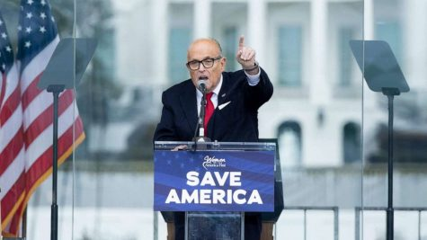 "Rudy Giuliani speaking at the ""March to Save America"" rally."