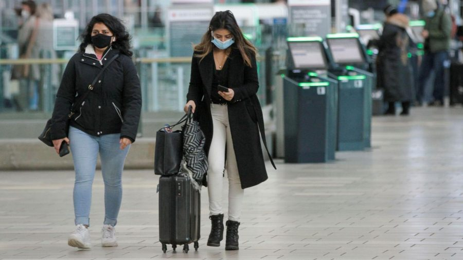 Passengers wearing face masks are seen at Vancouver International Airport.