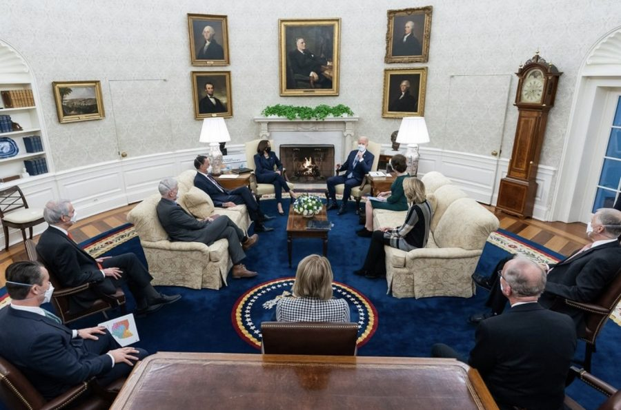 The group of 10 Republican senators, Vice President Harris, and President Biden sitting together in the White House.