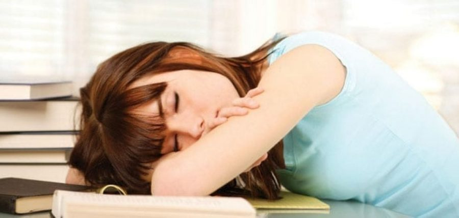 Image of a girl sleeping on desk taken from an article from yourteenmag.com.