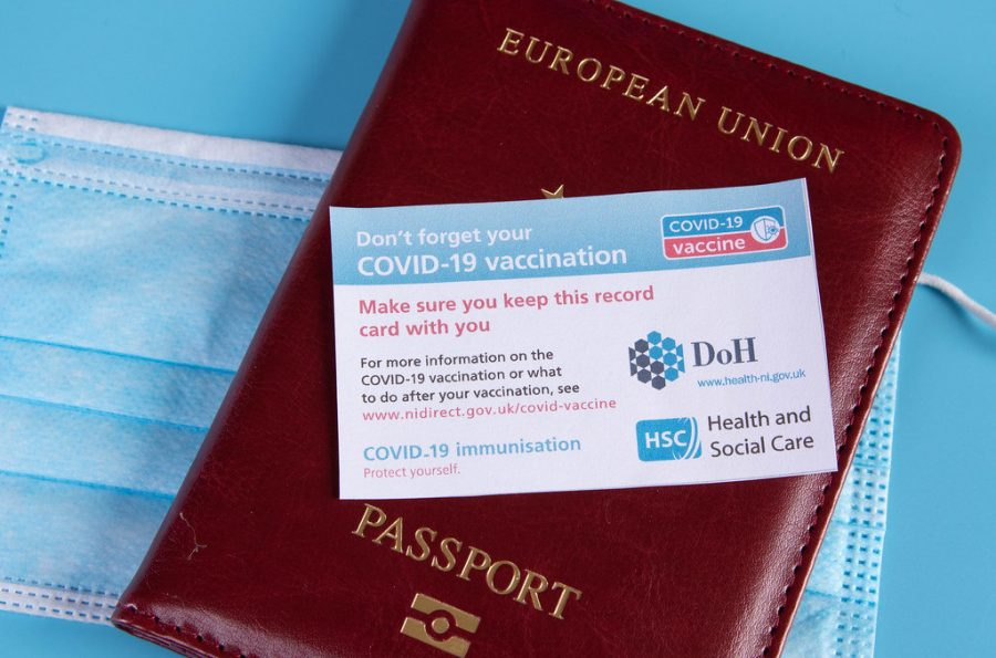 Image of a passport with a vaccine passport.