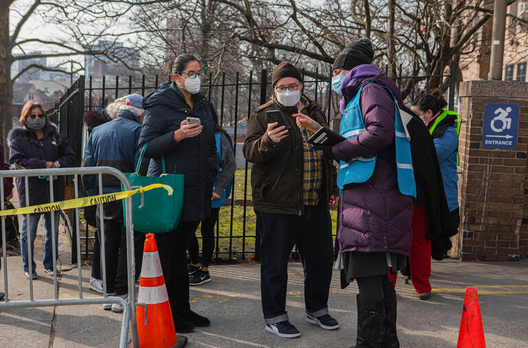 New Yorkers wait in line for COVID-19 vaccine.