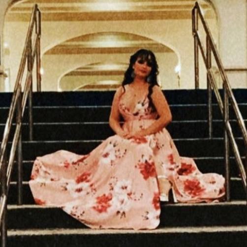 Caroline Centeno is sitting on stairs